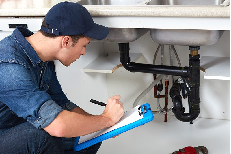 Professional plumber doing renovation in kitchen home.